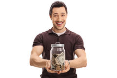 Joyful guy holding a jar full of money Royalty Free Stock Photo