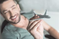 Joyful guy is holding little aircraft Stock Photography