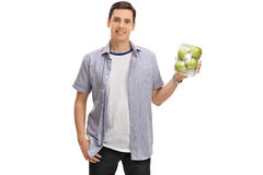 Joyful guy holding a pack of apples Stock Photo