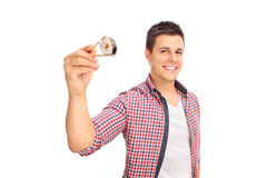 Joyful guy holding a piece of sushi Royalty Free Stock Image