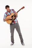 Joyful guy playing guitar. Royalty Free Stock Photo
