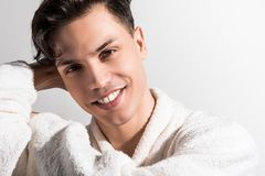 Joyful guy is relaxing after shower royalty free stock images