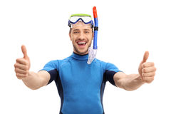 Joyful guy in a wetsuit making a thumbs up gesture Royalty Free Stock Image