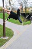 Joyful gymnast doing exercise Royalty Free Stock Photo