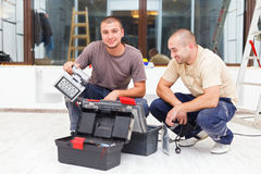 Joyful Handy Men and Their Tool Boxes Royalty Free Stock Photography