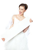 Joyful and happy bride shows a blank poster. Stock Photography