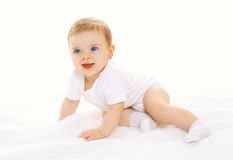 Joyful happy cute baby playing and crawls Stock Photos