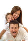 Joyful, happy family. Excited, happy young family in a joyful huddle royalty free stock images
