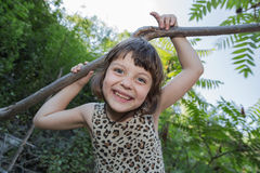 Joyful happy little girl with funny face playing in park Stock Images