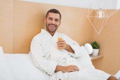 Joyful happy man enjoying his drink. Fresh juice. Joyful happy man enjoying his drink while resting at home Royalty Free Stock Photo
