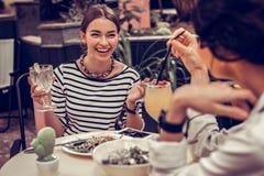 Joyful happy nice women having lunch together royalty free stock photo
