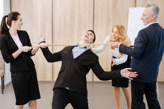 Joyful happy people cheering up their colleague Royalty Free Stock Photography