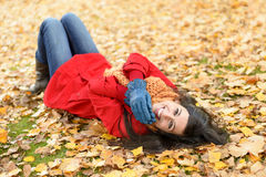 Joyful happy woman on autumn Royalty Free Stock Images