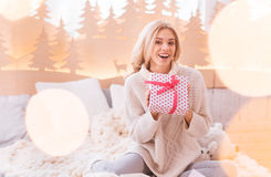 Joyful happy woman showing her present to you Royalty Free Stock Image