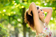 Joyful happy woman on spring park Royalty Free Stock Photos