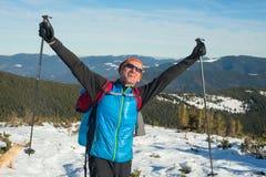 Joyful hiker in the winter mountains. Joyful hiker wearing sunglasses enjoying life in the winter mountains Royalty Free Stock Photo