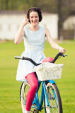Joyful hipster doing like or thumbup gesture in the park. While riding the bicycle Royalty Free Stock Photos