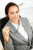 Joyful hispanic businesswoman holding glasses Stock Photography