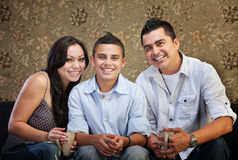 Joyful Hispanic Family. Joyful Native American family sitting together indoors Royalty Free Stock Photos