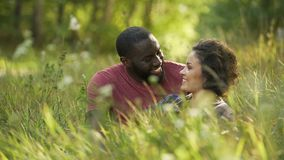 Joyful husband and thrilled wife spending free time in local park, married life. Stock footage stock video footage