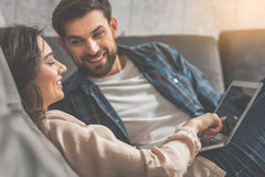 Joyful husband and wife relaxing at home royalty free stock images