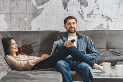 Joyful husband and wife resting with modern technology Royalty Free Stock Image
