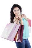 Joyful indian woman carrying shopping bags Stock Image