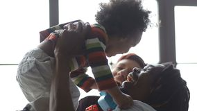 Joyful interracial family and son lounging at home stock video