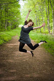 Joyful Jumping Woman Stock Images