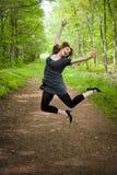 Joyful Jumping Woman Stock Images