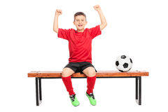 Joyful junior soccer player gesturing happiness Stock Images