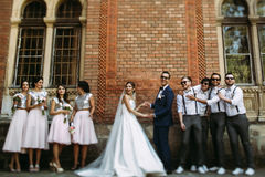 Joyful just married couple with the stylish friends Stock Photo