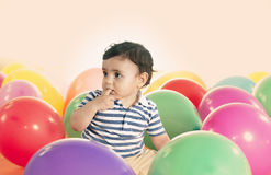 Joyful kid boy on birthday party with ballons warm filter applie Royalty Free Stock Photos