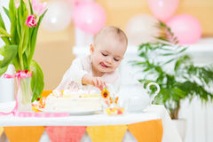 Baby girl at birthday table Royalty Free Stock Photos