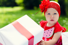 Joyful kid girl with colorful gift boxes Stock Photography