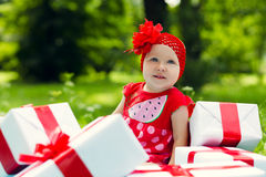 Joyful kid girl with colorful gift boxes Royalty Free Stock Photo