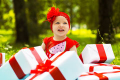 Joyful kid girl with colorful gift boxes Royalty Free Stock Image