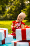 Joyful kid girl with colorful gift boxes Royalty Free Stock Images