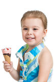 Joyful kid girl eating ice cream in studio isolated Royalty Free Stock Photos