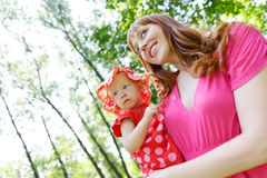 Joyful kid girl and mother Royalty Free Stock Images