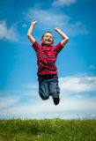 Joyful kid jumping happy Royalty Free Stock Photo