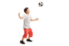 Joyful kid playing football royalty free stock photo
