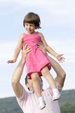 Joyful kid playing with her dad Stock Photography
