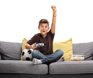 Joyful kid playing soccer video game Stock Photo