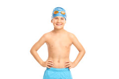 Joyful kid with swim cap and swimming goggles. Joyful little kid with a blue swim cap and orange swimming goggles looking at the camera isolated on white Stock Photo