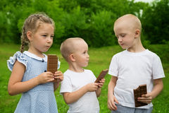 Joyful kids eating chocolate Stock Image