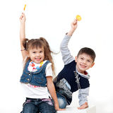 Joyful kids with sweet candies Royalty Free Stock Photos
