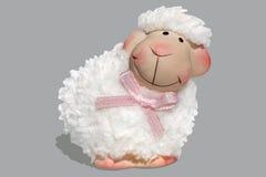 Joyful lamb. Lamb - souvenir on a gray background Stock Photo