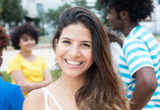 Joyful laughing caucasian woman with large group of international students royalty free stock photography