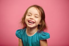 Joyful laughter of cheerful child girl, isolated portrait. Joyful laughter of cheerful child, beautiful girl expresses sincere happiness and fun emotions, happy Stock Photography